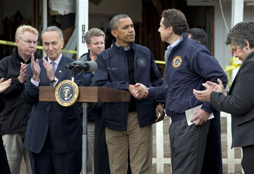 President Obama shakes hands with New York Gov. Andrew Cuomo, during a news conference on Cedar Grove Avenue, a street significantly impacted by Superstorm Sandy, on Staten Island, Thursday, Nov. 15, 2012, in New York. Sen. Charles Schumer, New York Democrat, is second from left, Secretary of Housing and Urban Development Shaun Donovan is third from left, and Secretary of Homeland Security Janet Napolitano is right. (AP Photo/Carolyn Kaster)