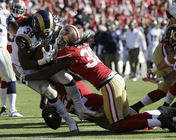 St. Louis Rams running back Steven Jackson carries the ball into the end zone for a touchdown past San Francisco 49ers free safety Dashon Goldson, right, during the first quarter of an NFL football game in San Francisco, Sunday, Nov. 11, 2012. (AP Pho