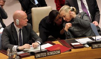 **FILE** United States Secretary of State Hillary Rodham Clinton (right) speaks Jan. 31, 2012, to Susan Rice, U.S. Ambassador to the United Nations, at United Nations headquarters as British Foreign Secretary William Hague listens to Syrian Ambassador to the United Nations Bashar Ja'afari address to a Security Council meeting on the situation in Syria. (Associated Press)