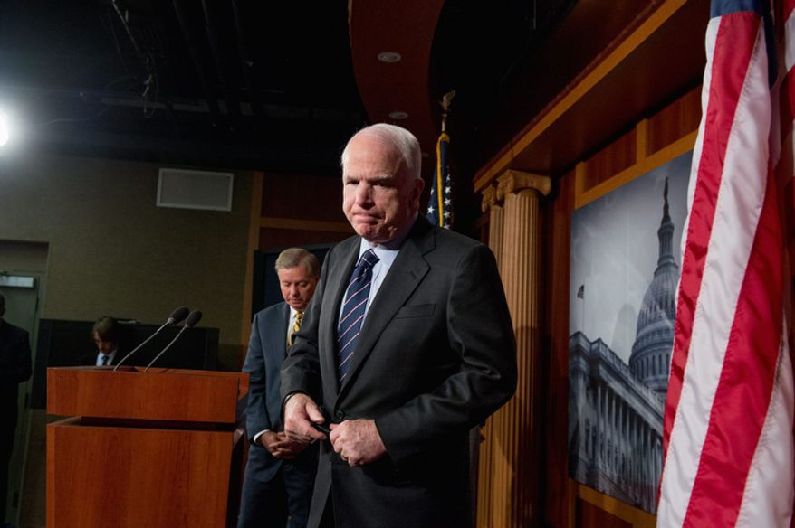 Republican Sens. John McCain (right) of Arizona and Lindsey Graham of South Carolina leave after holding a press conference at the U.S. Capitol on Nov. 14, 2012. The senators called for a hearing on the Benghazi attack. (Andrew Harnik/The Washington Times)