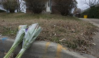 Flowers have been placed outside a house in Riverdale on Thursday, Nov. 15, 2012 where a man was fatally shot Wednesday night by a Prince George's County sheriff's deputy who was attempting to serve a peace order. The man allegedly brandished some sort of weapon, which turned out to be a replica. (Barbara L. Salisbury/The Washington Times)