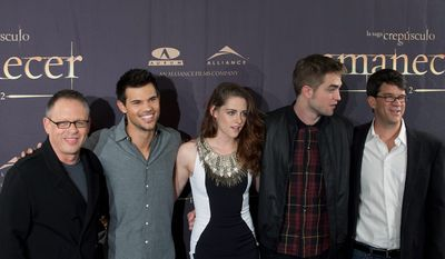 "From left to right, film director Bill Condon,  poses with actors Taylor Lautner, Kristen Stewart, Robert Pattinson and the producer Wyck Godfrey during a photo call for the film  ""The Twilight Saga: Breaking Dawn Part 2"" in Madrid, Spain, Thursday, Nov. 15, 2012. ( AP Photo/Gabriel Pecot)"