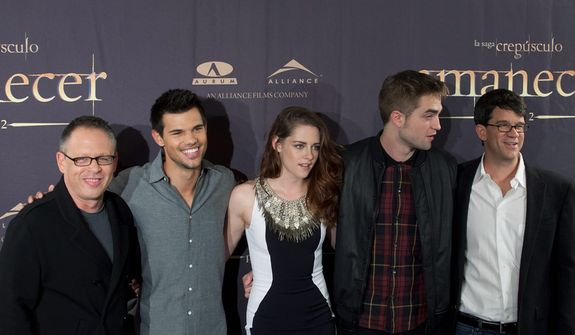 """From left to right, film director Bill Condon,  poses with actors Taylor Lautner, Kristen Stewart, Robert Pattinson and the producer Wyck Godfrey during a photo call for the film  """"The Twilight Saga: Breaking Dawn Part 2"""" in Madrid, Spain, Thursday, Nov. 15, 2012. ( AP Photo/Gabriel Pecot)"""
