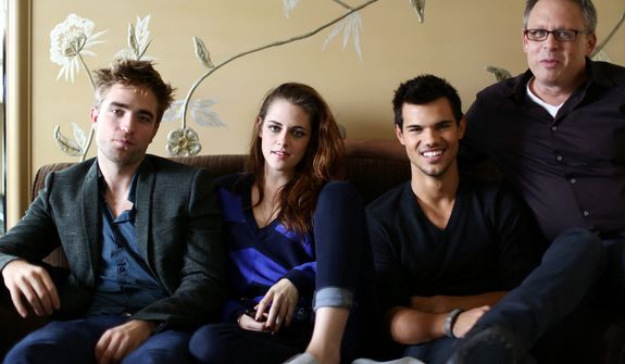 """In this Thursday, Nov. 1, 2012 photo, from left, actor Robert Pattinson, actress Kristen Stewart, actor Taylor Lautner, and director Bill Condon, from the upcoming film """"The Twilight Saga: Breaking Dawn Part 2,"""" pose for a portrait in Los Angeles. ìTwilightî rocketed Stewart and Pattinson to superstardom, and their real-life romance only propelled them further. With the release on Friday, Nov. 16, 2012 of the final film in the franchise, ìThe Twilight Saga: Breaking Dawn Part 2,î the young actors bid farewell to the worldwide fantasy sensation.  (Photo by Matt Sayles/Invision/AP)"""