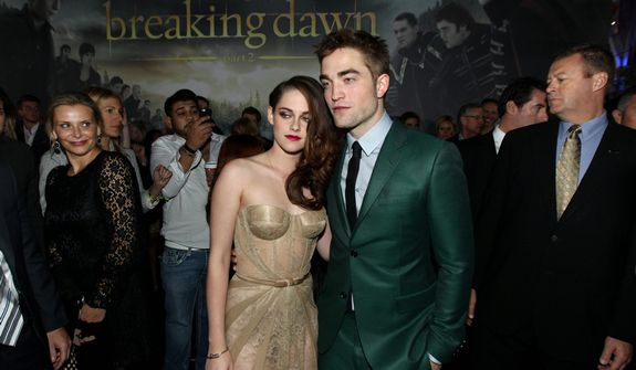 """Kristen Stewart, left, and Robert Pattinson attend the world premiere of """"The Twilight Saga: Breaking Dawn Part 2"""" at the Nokia Theatre on Monday, Nov. 12, 2012, in Los Angeles. (Photo by Matt Sayles/Invision/AP)"""