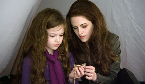 """This film image released by Summit Entertainment shows Mackenzie Foy, left, and Kristen Stewart in a scene from """"The Twilight Saga: Breaking Dawn Part 2."""" (AP Photo/Summit Entertainment, Andrew Cooper)"""
