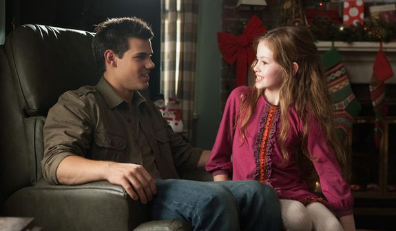 """This film image released by Summit Entertainment shows Taylor Lautner, left, and Mackenzie Foy in a scene from """"The Twilight Saga: Breaking Dawn Part 2."""" (AP Photo/Summit Entertainment, Andrew Cooper)"""