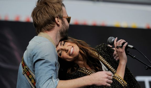 """Nikki Reed, a cast member in the film """"The Twilight Saga: Breaking Dawn Part 2,"""" is embraced by her husband, singer Paul McDonald, as they perform together onstage during the Twilight Fan Camp Concert outside Nokia Theater L.A. Live, Saturday, Nov. 10. 2012, in Los Angeles. The world premiere of the film will be held at Nokia Theater L.A. Live on Monday. (Photo by Chris Pizzello/Invision/AP)"""