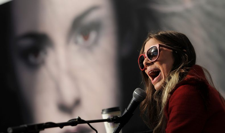 """Singer Christina Perri performs during the Twilight Fan Camp Concert outside Nokia Theater L.A. Live, Saturday, Nov. 10. 2012, in Los Angeles. The world premiere of the film """"The Twilight Saga: Breaking Dawn Part 2"""" will be held at Nokia Theater L.A. Live on Monday. (Photo by Chris Pizzello/Invision/AP)"""