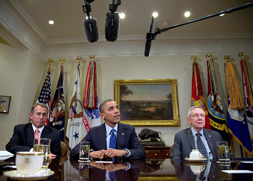 President Barack Obama, flanked by House Speaker John Boehner of Ohio, left, and Senate Majority Leader Harry Reid of Nev., speaks to reporters in the Roosevelt Room of the White House in Washington, Friday, Nov. 16, 2012, as he hosted meeting of the bipartisan, bicameral leadership of Congress to discuss the deficit and economy.  (AP Photo/Carolyn Kaster)