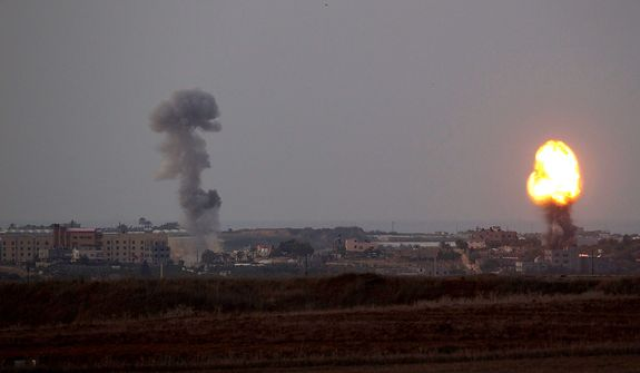 Explosion and smoke rise following an Israeli strike in the Gaza Strip, seen from the Israel Gaza Border, southern Israel, Friday, Nov. 16, 2012. (AP Photo/Ariel Schalit)