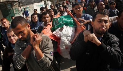 Relatives and friends carry the body of Palestinian Uday Nasser during his funeral in Beit Hanoun, north Gaza, Friday, Nov. 16, 2012. Relatives say Nasser was killed after an Israeli airstrike hit his family house. (AP Photo/Hatem Moussa)