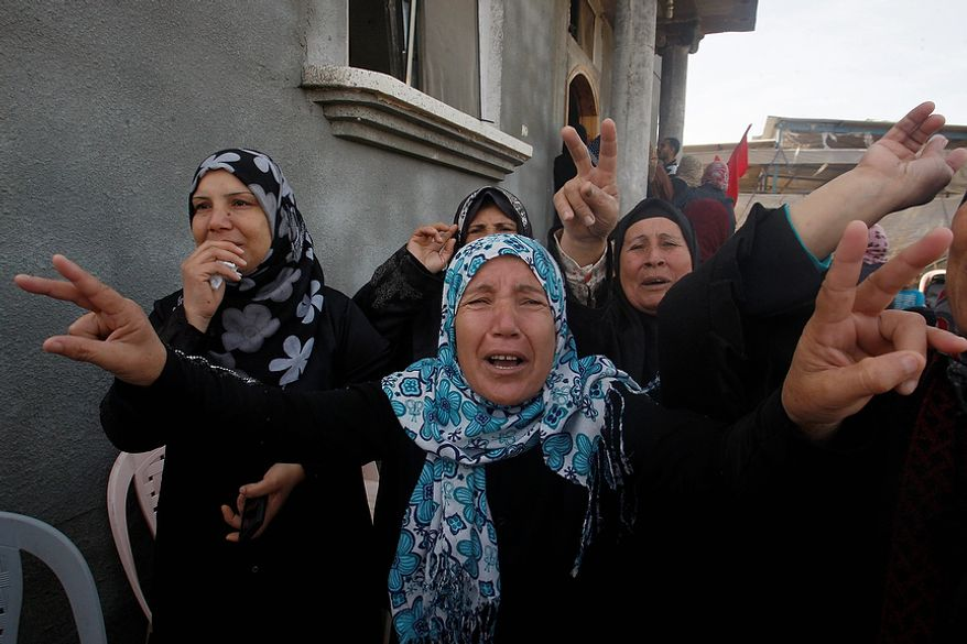 Relatives and friends mourn during the funeral of Palestinian child Faris Basyoni in Beit Hanoun, north Gaza, Friday, Nov. 16, 2012. Basyoni was killed after an Israeli airstrike hit his family house, according to relatives. (AP Photo/Hatem Moussa)