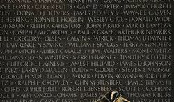 A pair of combat boots lat the the foot of one of the wall panels of names at the Vietnam Veterans Memorial during Veteran's Day weekend in Washington, D.C., Sunday, Nov. 11, 2012. (Rod Lamkey Jr./The Washington Times)
