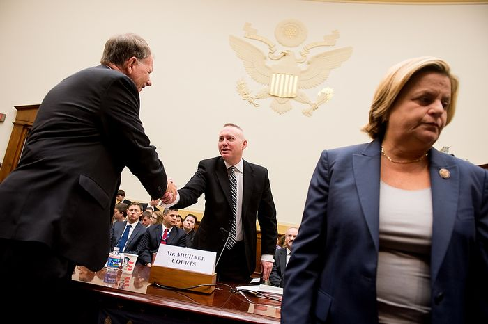 Rep. Ted Poe (R-Texas), left, and Chairman Ileana Ros-Lehtinen (R-Fla.) of the House Committee on Foreign Affairs, right,  greets Government Accountability Office International Affairs and Trade Acting Director Michael Courts, center, before he testifies at a House Committee on Foreign Affairs hearing in the Rayburn Office Building on the September 11, 2012 attack on the american consulate in Benghazi, Washington, D.C., Thursday, November 15, 2012. (Andrew Harnik/The Washington Times)