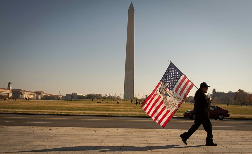 A man walks past the World War II Memorial following the Veterans Day at the National World War II Memorial event in Washington, D.C., Sunday, Nov. 11, 2012. (Rod Lamkey Jr./The Washington Times)