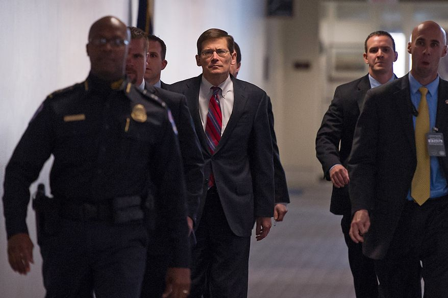 CIA Deputy Director Michael Morell, center, arrives for a closed door Senate Select Committee on Intelligence hearing to discuss the September 11, 2012 attack on the U.S. Consulate in Benghazi, Libya, and the intelligence and security situation in other Arab Spring countries at the Hart Senate Office Building, Washington, D.C., Thursday, November 15, 2012. (Andrew Harnik/The Washington Times)