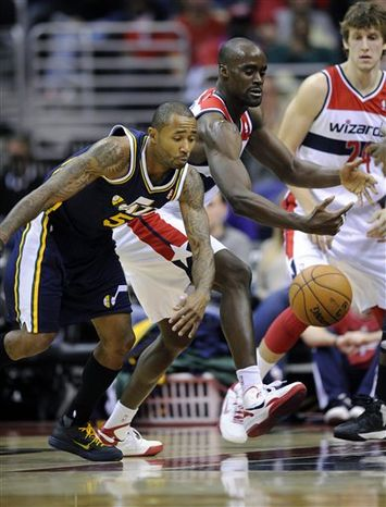 Utah Jazz's Mo Williams (5) and Washington Wizards' Emeka Okafor, right, chase after a loose ball during the first half of an NBA basketball game, Saturday, Nov. 17, 2012, in Washington. (AP Photo/Nick Wass)