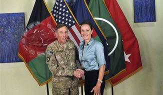 "** FILE ** This July 13, 2011, photo made available on the International Security Assistance Force's Flickr website shows U.S. Army Gen. David H. Petraeus shaking hands with Paula Broadwell, co-author of ""All In: The Education of General David Petraeus."" (AP Photo/International Security Assistance Force)"