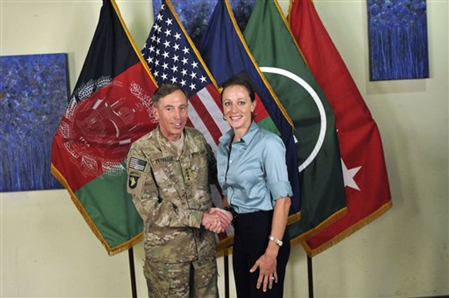 """** FILE ** This July 13, 2011, photo made available on the International Security Assistance Force's Flickr website shows U.S. Army Gen. David H. Petraeus shaking hands with Paula Broadwell, co-author of """"All In: The Education of General David Petraeus."""" (AP Photo/International Security Assistance Force)"""