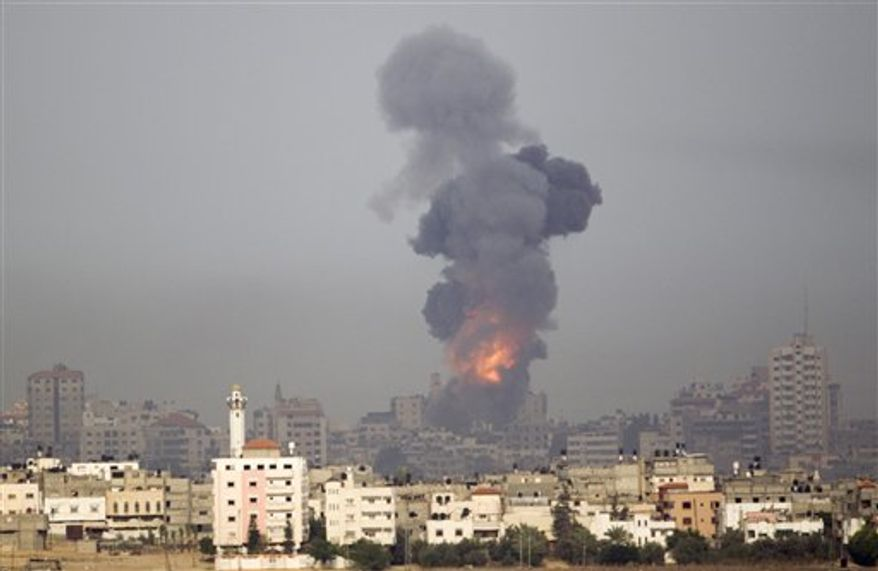 Explosion and smoke rise following an Israeli strike in Gaza, seen from the Israel Gaza Border, southern Israel, Saturday, Nov. 17, 2012. Israel bombarded the Hamas-ruled Gaza Strip with more than 180 airstrikes early Saturday, the military said, widening a blistering assault on militant operations to include the prime minister's headquarters, a police compound and a vast network of smuggling tunnels. The new attacks followed an unprecedented rocket strike aimed at the contested holy city of Jerusalem that raised the stakes in Israel's violent confrontation with Palestinian militants. (AP Photo/Ariel Schalit)