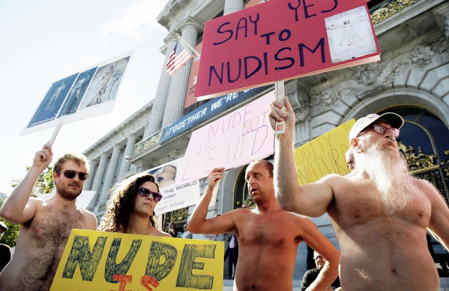 Demonstrators gather at City Hall in San Francisco to protest a proposed nudity ban. City lawmakers appear poised to shed its image as a city where anything goes, including clothing. The vote is Tuesday. (Associated Press)
