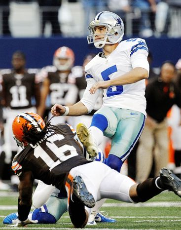 Dallas kicker Dan Bailey follows through on a 32-yard field goal with 2 seconds left in regulation. Bailey hit from 38 yards in overtime to seal a 23-