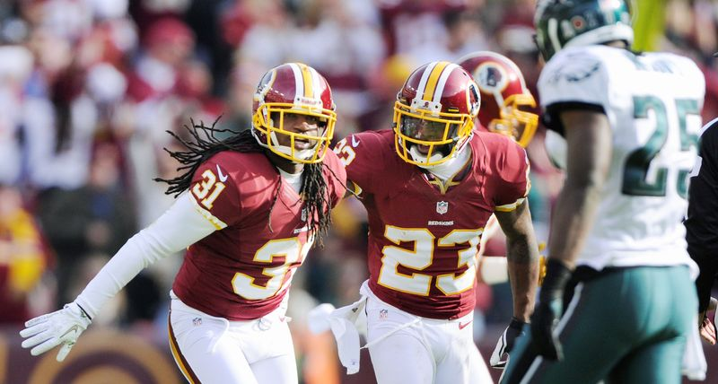 Playing in his first game this year, Redskins free safety Brandon Meriweather (left) celebrates his second-quarter interception with cornerback DeAngelo Hall. Meriweather suffered a torn ACL in the win against