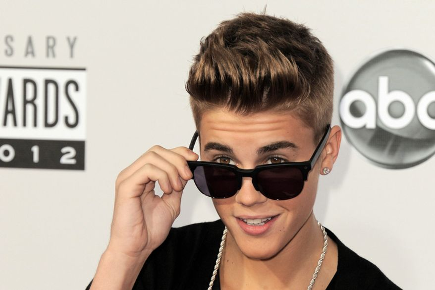 ** FILE ** Justin Bieber arrives at the 40th Anniversary American Music Awards on Sunday, Nov. 18, 2012, in Los Angeles. (Photo by Jordan Strauss/Invision/AP)
