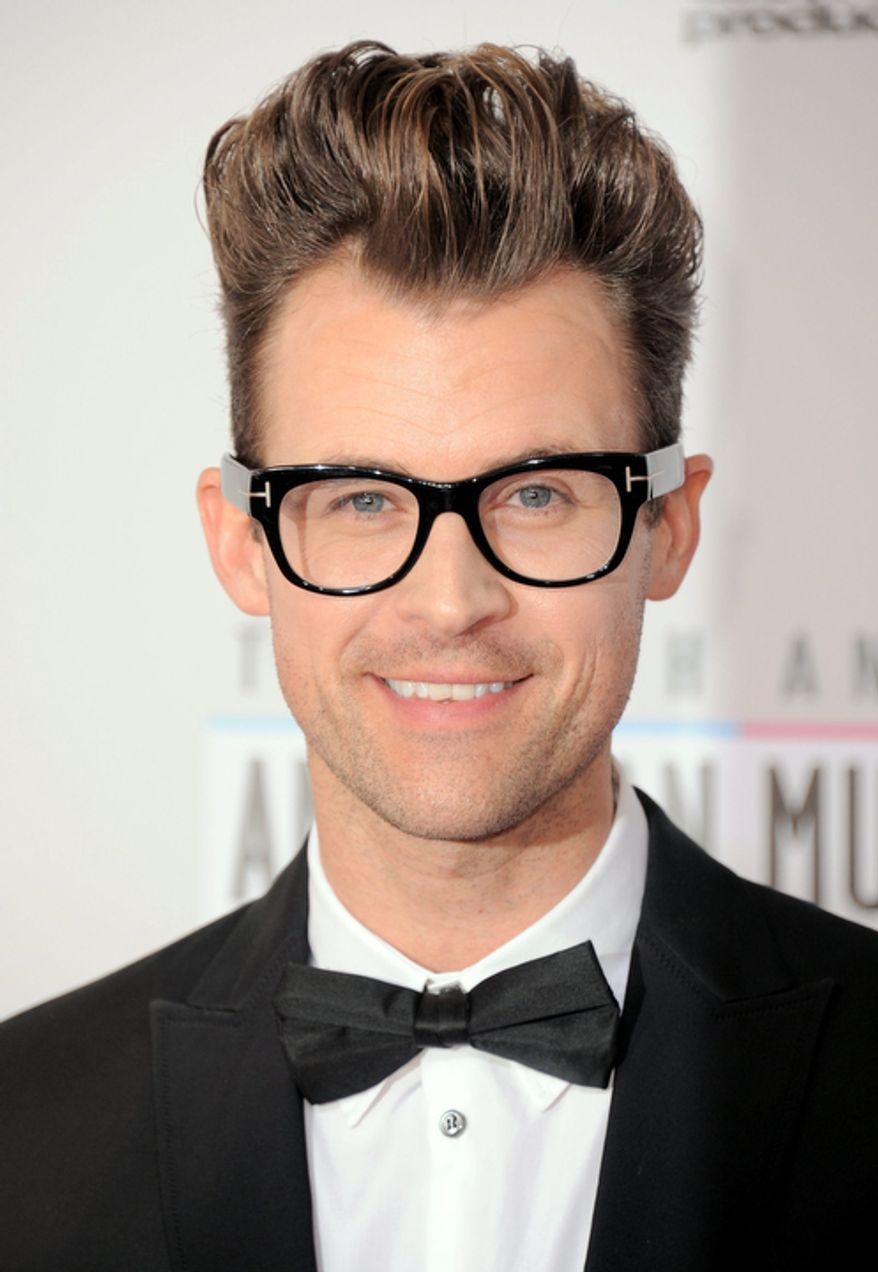 Stylist and TV personality Brad Goreski arrives at the 40th Anniversary American Music Awards on Sunday Nov. 18, 2012, in Los Angeles. (Photo by Jordan Strauss/Invision/AP)