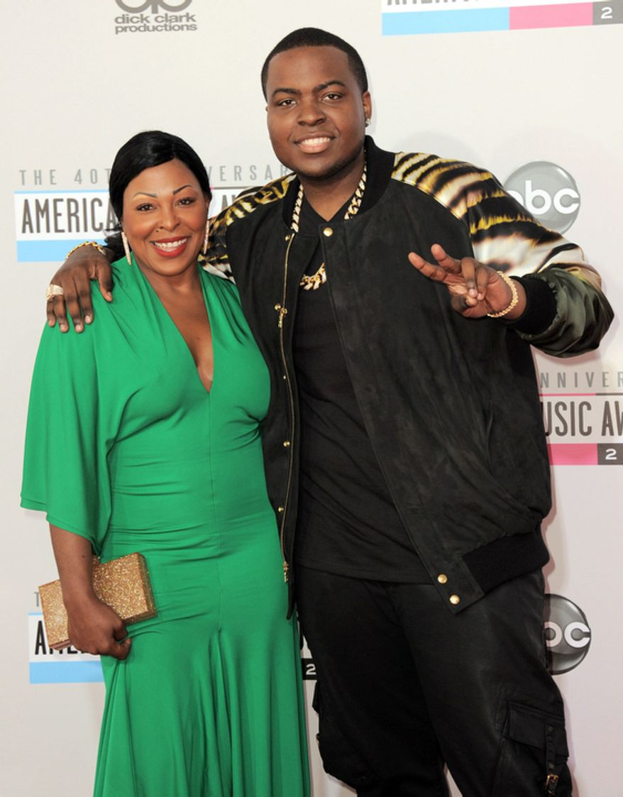 Sean Kingston, right, and his mother Janice Turner arrive at the 40th Anniversary American Music Awards on Sunday Nov. 18, 2012, in Los Angeles. (Photo by Jordan Strauss/Invision/AP)