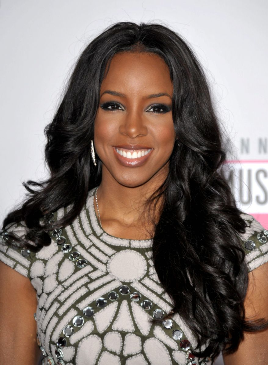 Kelly Rowland arrives at the 40th Anniversary American Music Awards on Sunday, Nov. 18, 2012, in Los Angeles. (Photo by John Shearer/Invision/AP)