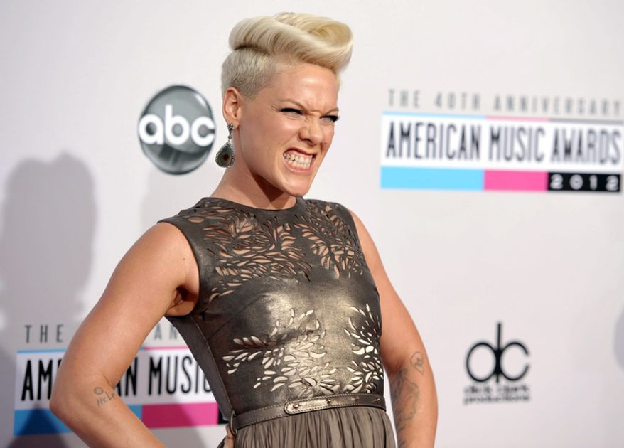 Pink arrives at the 40th Anniversary American Music Awards on Sunday, Nov. 18, 2012, in Los Angeles. (Photo by John Shearer/Invision/AP)