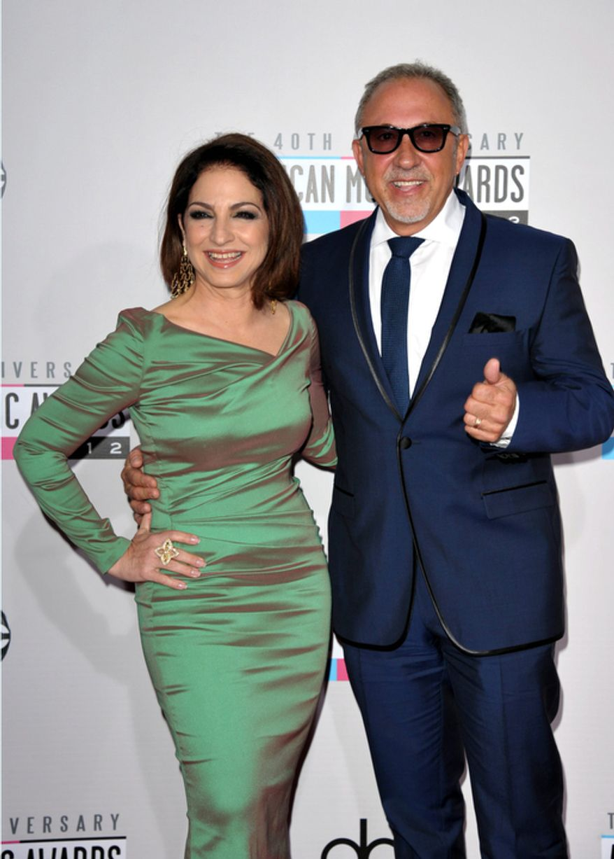 Gloria Estefan, left, and Emilio Estefan, Jr. arrive at the 40th Anniversary American Music Awards on Sunday, Nov. 18, 2012, in Los Angeles. (Photo by John Shearer/Invision/AP)