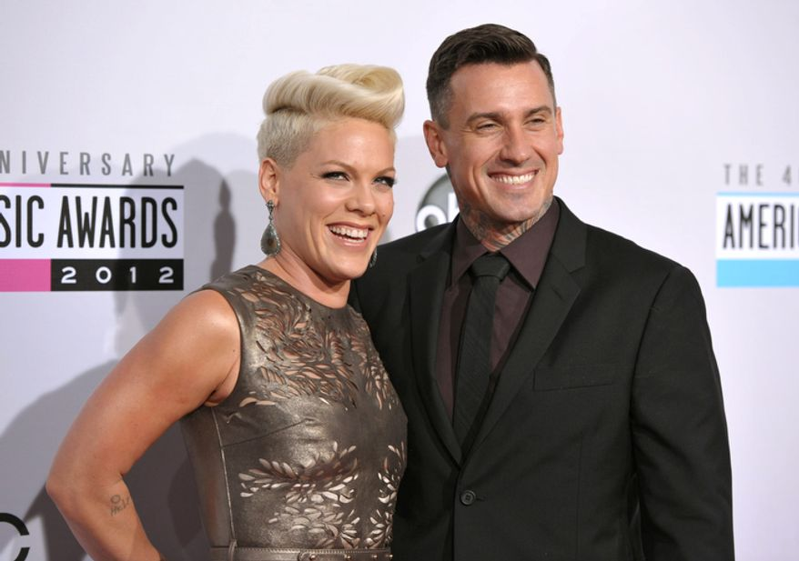 Pink, left, and Carey Hart arrive at the 40th Anniversary American Music Awards on Sunday, Nov. 18, 2012, in Los Angeles. (Photo by John Shearer/Invision/AP)