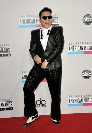 South Korean rapper PSY arrives at the 40th Anniversary American Music Awards on Sunday, Nov. 18, 2012, in Los Angeles. (Photo by Joh