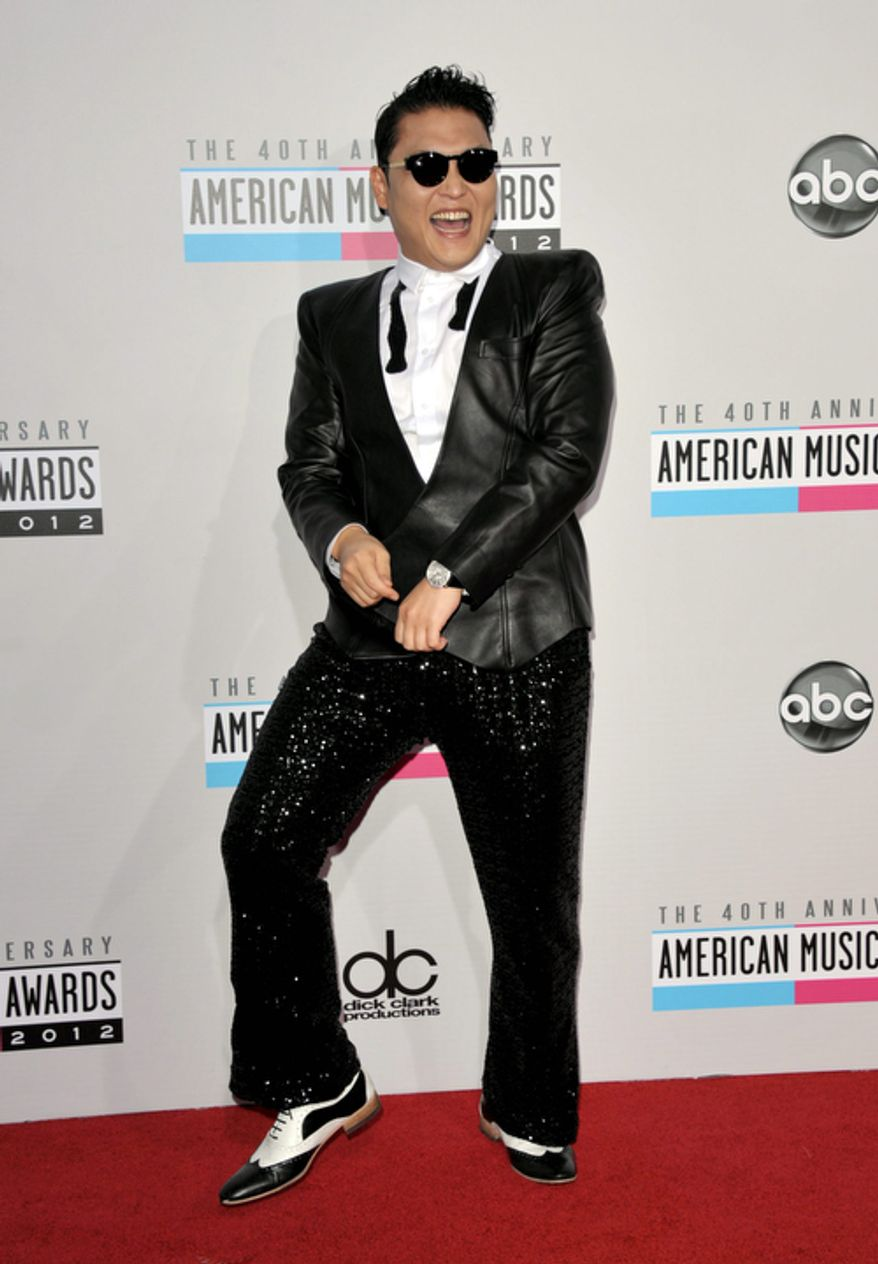 South Korean rapper PSY arrives at the 40th Anniversary American Music Awards on Sunday, Nov. 18, 2012, in Los Angeles. (Photo by John Shearer/Invision/AP)