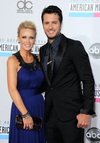 Luke Bryan, right, and Caroline Boyer arrive at the 40th Anniversary American Music Awards on Sunday, Nov. 18, 2012, in Los Angeles. (Photo by Jordan Strauss/Invision/AP)