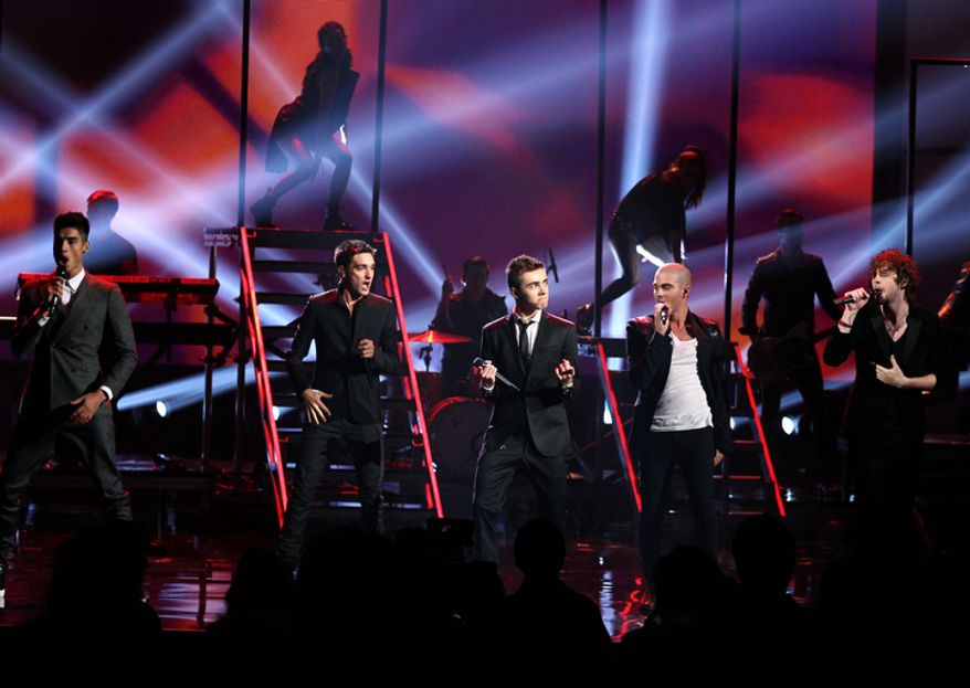 CORRECTS POSITIONS - The Wanted, from left, Siva Kaneswaran,Tom Parker, Nathan Sykes, Max George and Jay McGuiness perform at the 40th Annual American Music Awards on Sunday, Nov. 18, 2012, in Los Angeles. (Photo by Matt Sayles/Invision/AP)