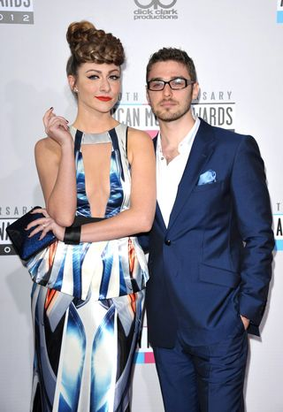Amy Heidemann, left, and Nick Noonan from the band Karmin arrive at the 40th Anniversary American Music Awards on Sunday, Nov. 1