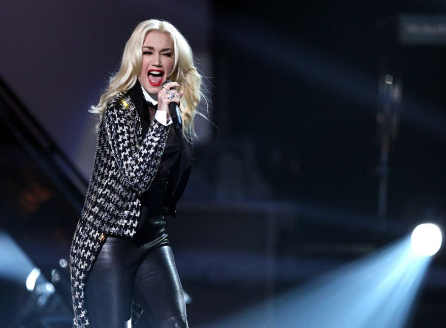 Gwen Stefani and No Doubt perform ìLooking Hotî at the 40th Annual American Music Awards on Sunday, Nov. 18, 2012, in Los Angeles. (Photo by Matt Sayles/Invision/AP)