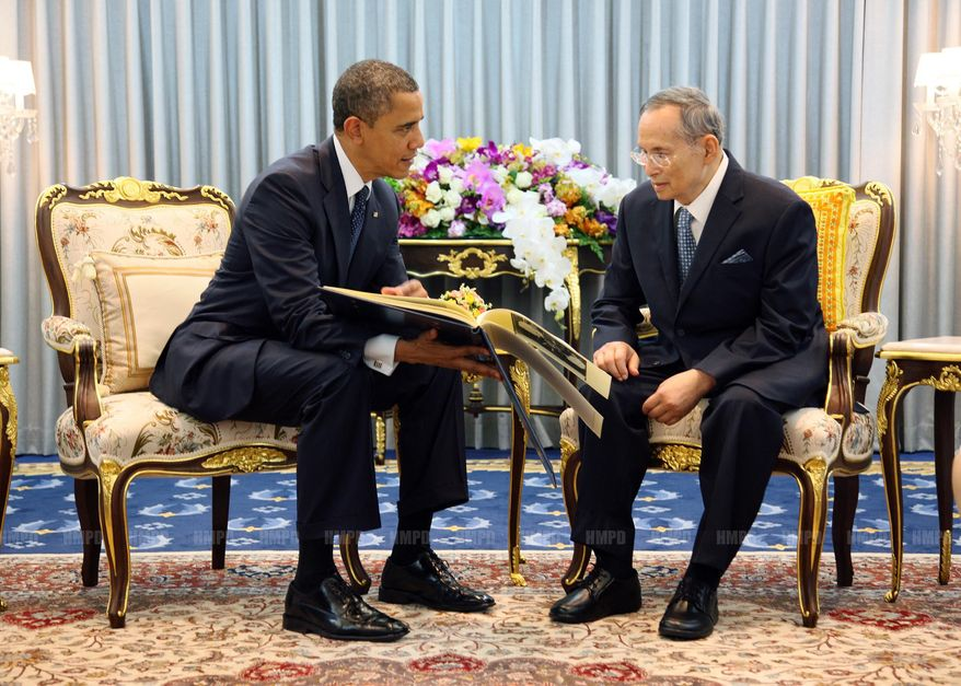 in this photo released by Thailand's Royal Household Bureau, U.S. President Barack Obama, left, talks with Thai King Bhumibol Adulyadej, right, at Siriraj Hospital in Bangkok, Thailand, Sunday, Nov. 18, 2012. (AP Photo/Royal Household Bureau)