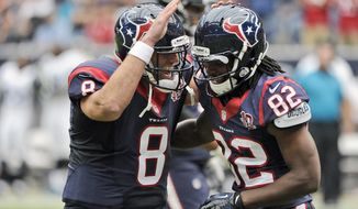 Houston Texans quarterback Matt Schaub (8) and Keshawn Martin (82) celebrates a touchdown during the first quarter of an NFL football game against the Jacksonville Jaguars Sunday, Nov. 18, 2012, in Houston. (AP Photo/Dave Einsel)
