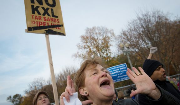 Hannah Moore, of Arlington, Va., shouts out in a chant during a short rally in front of The White House to protest the Keystone Pipeline, in a march which began at Freedom Plaza, in Washington, D.C., Sunday, Nov. 18, 2012. (Rod Lamkey Jr./The Washington Times)