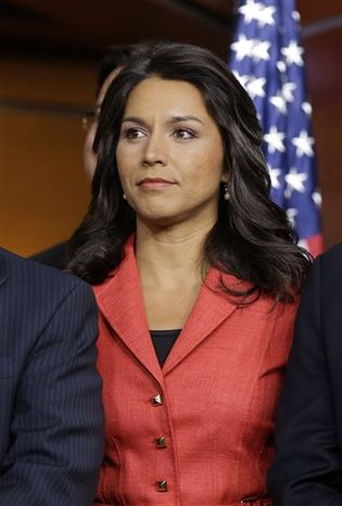 Rep.-elect Tulsi Gabbard, Hawaii Democrat, is seen on stage during a news conference with newly elected Democratic House members, on Capitol Hill in Washington, Tuesday, Nov. 13, 2012. (Associated Press)