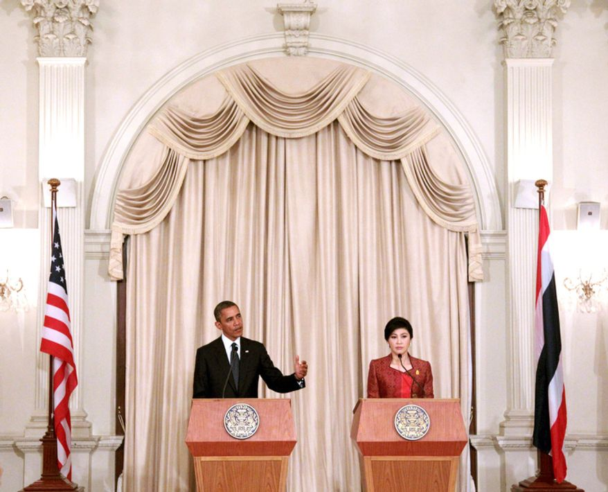 U.S. President Barack Obama, left, speaks as Thai Prime Minister Yingluck Shinawatra listens during a joint press conference at the Government House in Bangkok, Thailand. (AP Photo/Sakchai Lalit)