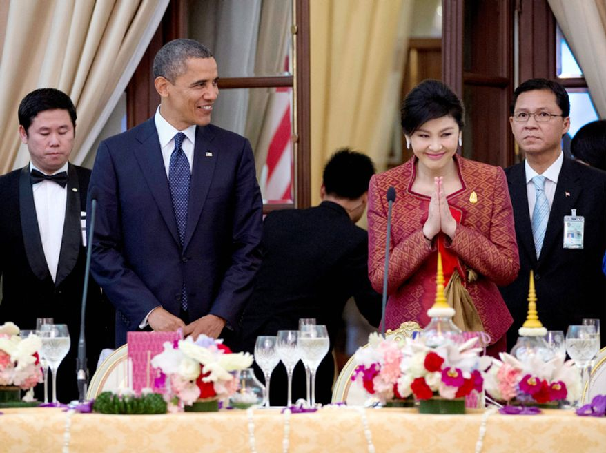 U.S. President Barack Obama, second left, and Thai Prime Minister Yingluck Shinawatra, second right, arrive for an official dinner at Government House in Bangkok, Thailand. (AP Photo/Carolyn Kaster)