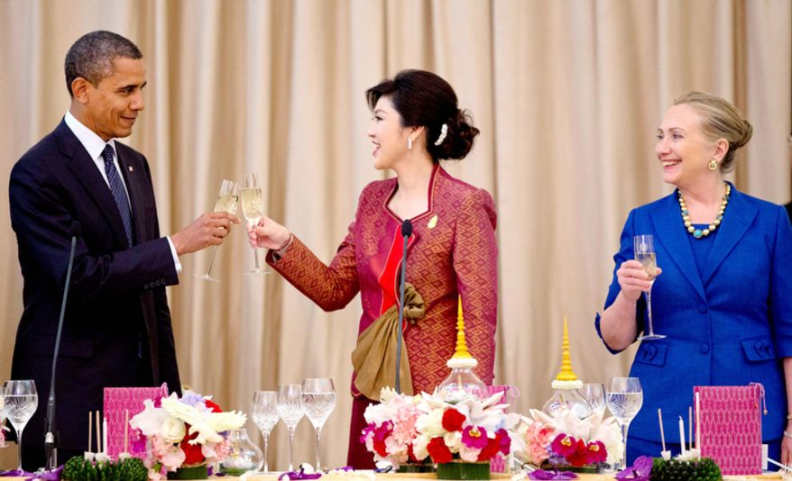 U.S. President Barack Obama, left, and Thai Prime Minister Yingluck Shinawatra toast during a official dinner as U.S. Secretary of State Hillary Rodham Clinton looks on from right at Government House in Bangkok, Thailand. (AP Photo/Carolyn Kaster)