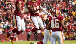 Washington Redskins fullback Darrel Young (36) celebrates with Washington Redskins quarterback Robert Griffin III (10) after Young scores on a six yard touchdown pass in the first quarter as the Washington Redskins play the Philadelphia Eagles at FedEx Field, Landover, Md., Sunday, Nov. 18, 2012. (Andrew Harnik/The Washington Times)