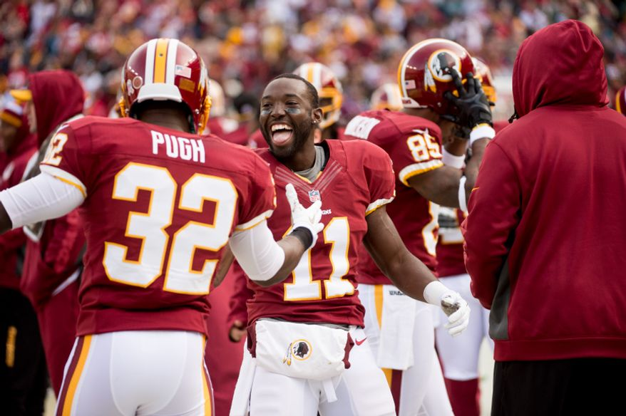 Washington Redskins wide receiver Aldrick Robinson (11), center, celebrates on the sideline after catching a 49 yard touchdown pass in the second quarter as the Washington Redskins play the Philadelphia Eagles at FedEx Field, Landover, Md., Sunday, Nov. 18, 2012. (Andrew Harnik/The Washington Times)